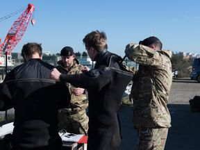 Royal Navy bomb disposal experts are working alongside the Metropolitan Police to safely remove a Second World War device found in the River Thames. Pic: © Crown copyright 2018
