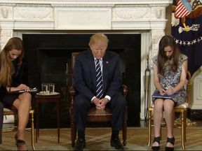 Donald Trump bowed his head in prayer with students