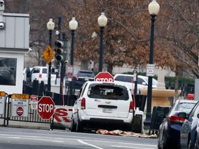 A white Chevrolet struck a security barrier near the White House