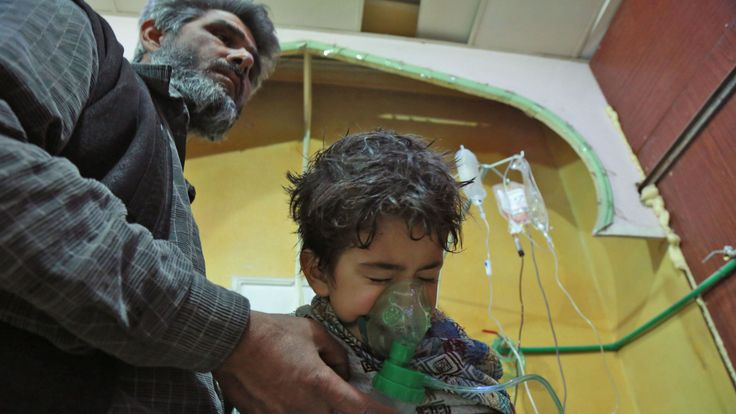 A Syrian child receives treatment for a suspected chemical attack in eastern Ghouta