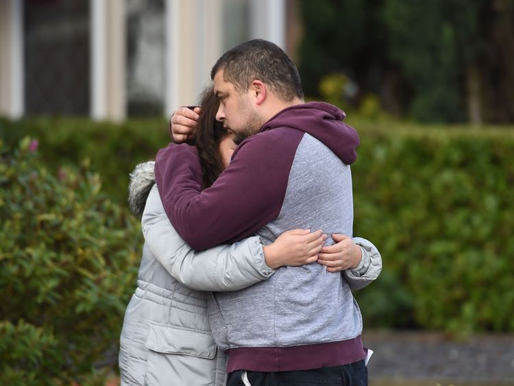 Reese Platt-May, the father of the brothers, hugs his sister Tia Fletcher close to the scene on Friday