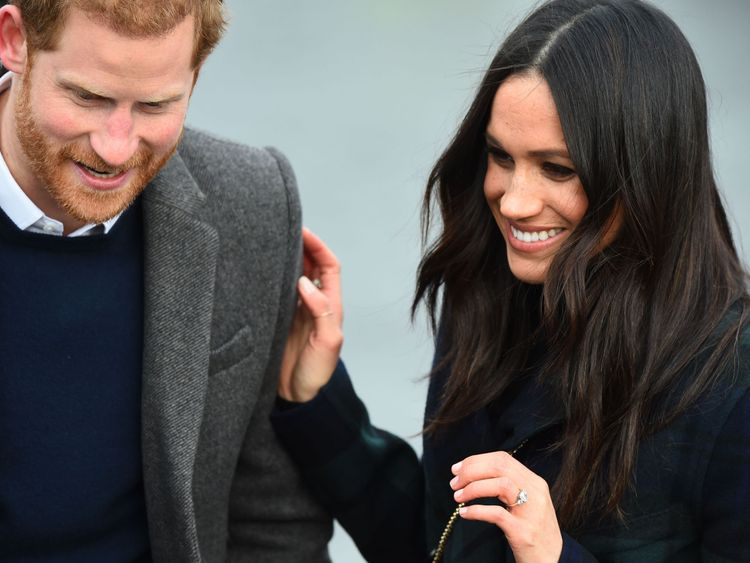 Britain's Prince Harry and his fiancée, US actress Meghan Markle smile during a walkabout on the Esplanade at Edinburgh Castle, during a visit to Scotland on February 13, 2018. / AFP PHOTO / Andy BUCHANAN (Photo credit should read ANDY BUCHANAN/AFP/Getty Images)