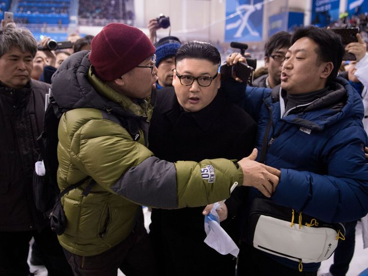 A Kim Jong Un impersonator is forced out in the final period of the women's preliminary round ice hockey match between Japan and the Unified Korean team during the Pyeongchang 2018 Winter Olympic Games at the Kwandong Hockey Centre in Gangneung on February 14, 2018.