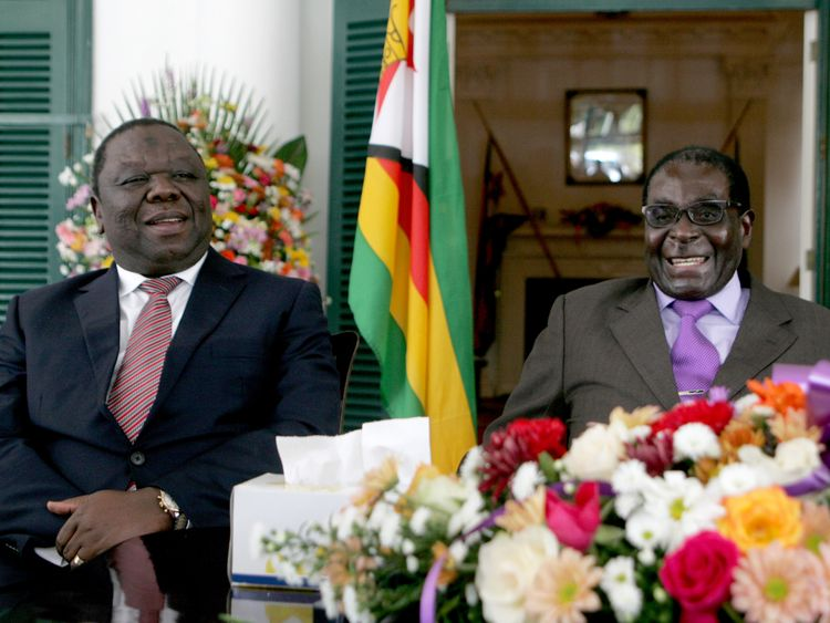 Zimbabwe's President Robert Mugabe (R) and Prime Minister Morgan Tsvangirai (L) announce the conclusion of the constitution making process at State House on January 17, 2013 in Harare. Mugabe said the country has concluded writing a draft constitution after all political parties agreed to the charter that is set to go for a referendum before elections this year. Mugabe and Tsvangirai formed a power-sharing government three years ago after violent and disputed polls in 2008. Their relations have
