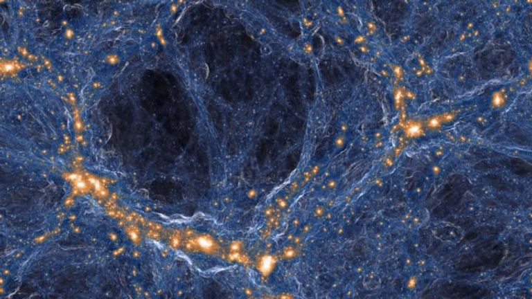 Visualization of the intensity of shock waves in the cosmic gas (blue) around collapsed dark matter structures (orange/white). Similar to a sonic boom, the gas in these shock waves is accelerated with a jolt when impacting on the cosmic filaments and galaxies.  Pic: IllustrisTNG collaboration