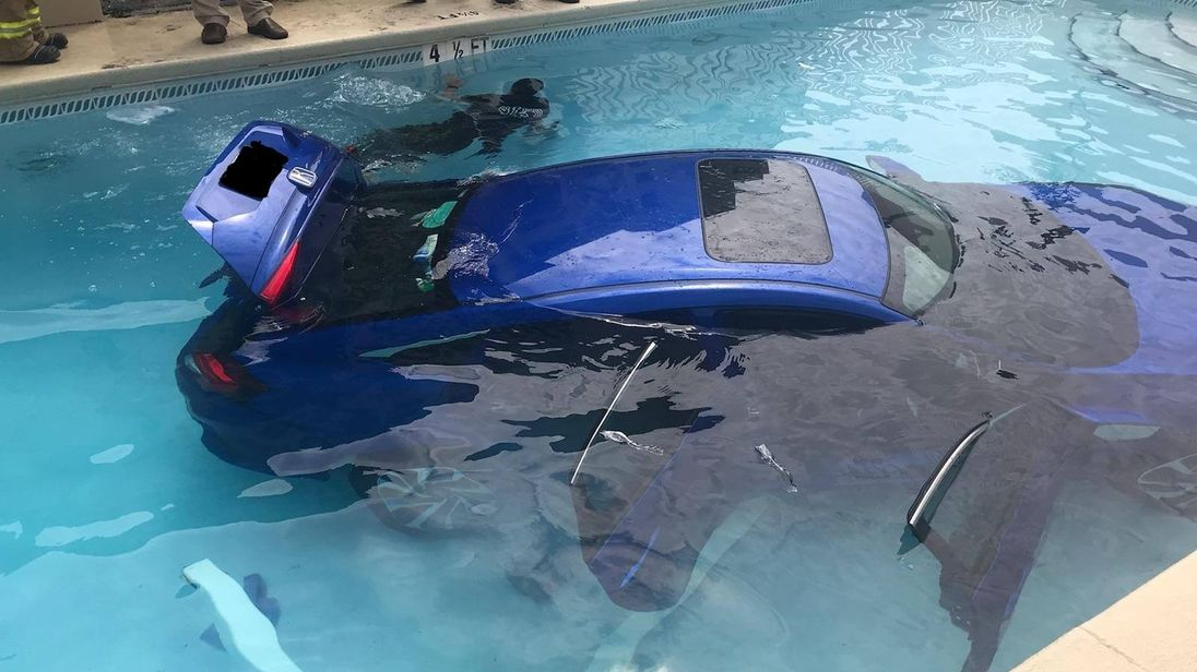 The woman's car ended up in the local swimming pool. Pic: Okaloosa County Sheriff's Office