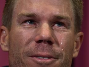 Australian cricketer David Warner cries as he speaks at a press conference at the Sydney Cricket Ground (SCG) in Sydney on March 31, 2018, after his return from South Africa