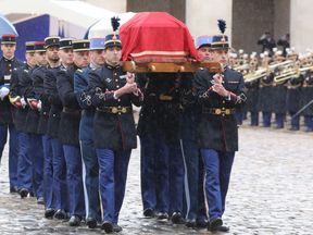 The coffin of Lieutenant-Colonel Arnaud Beltrame is carried to the Hotel des Invalides in Paris