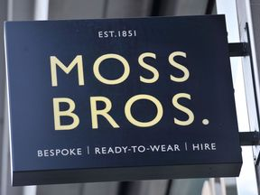 File photo dated 06/01/16 of a sign for suit tailoring retailer Moss Bros which has warned over profits after sales suffered a triple whammy from stock shortages, low footfall and sluggish suit hire demand.