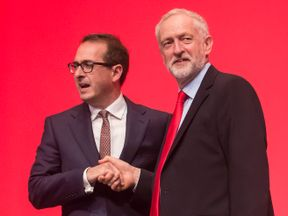 Owen Smith (L) and Jeremy Corbyn