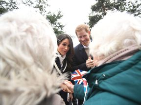 Prince Harry and Meghan Markle meet members of the public on a walkabout during a visit to Millennium Point in Birmingham