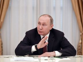 Russian President and presidential candidate Vladimir Putin meets with other candidates in the poll