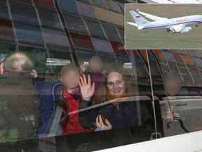 People waved as their van left the Russian Embassy in London