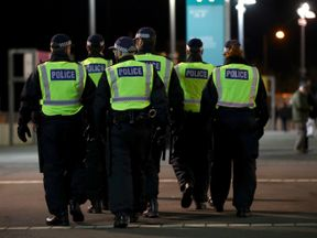 The Police are seen outside the stadium prior to the Premier League match between Tottenham Hotspur and West Ham United at Wembley Stadium on January 4, 2018 in London, England