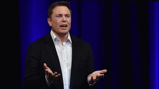 Elon Musk speaking at news conference in LA