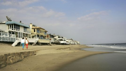 MALIBU, CA - APRIL 18:  Luxurious beach houses crowd the shoreline hiding Carbon Beach, a public beach that was gotten to through a recently opened public accessway next to music producer David Geffen's beach house, on April 18, 2005 in Malibu, California. The gate was found re-locked later that afternoon. By opening the gate, Geffen would be fulfilling a 22-year-old legal promise to open a public pathway across his property in exchange for permits from the Coastal Commission to begin building his Cape Cod-style compound across multiple lots on Carbon Beach. In giving up the gate key, the music mogul also stops daily fines of $1,000 a day from accumulating.  (Photo by David McNew/Getty Images)
