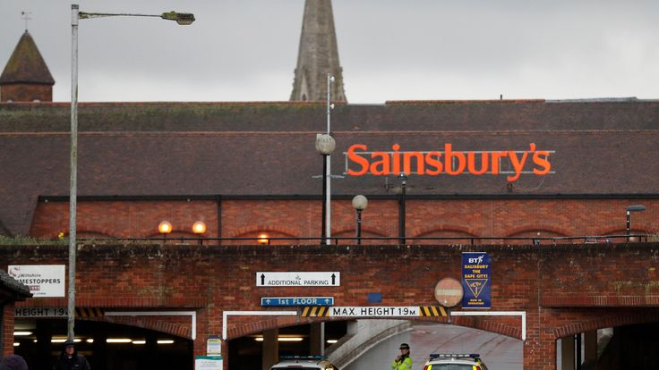 Officers stand at the cordon in Sainsburys, Salisbury