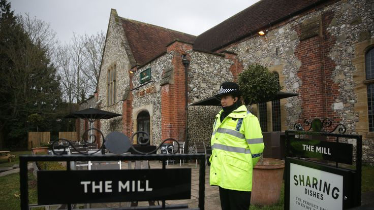 A police officer stands in front of a cordon in front of The Mill pub in Salisbury
