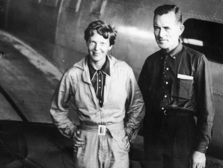 American aviatrix Amelia Earhart (1897 - 1937) with her navigator, Captain Fred Noonan, in the hangar at Parnamerim airfield, Natal, Brazil, 11th June 1937