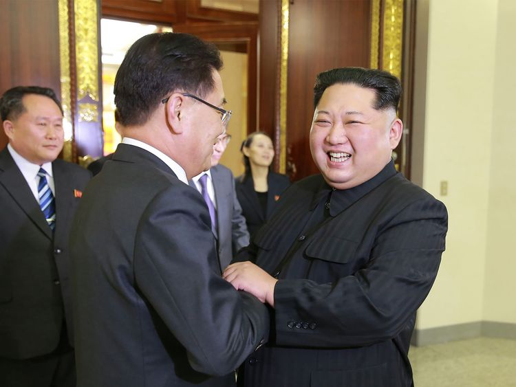 Kim Jong Un was pictured enthusiastically greeting the South's Chung Eui-yong