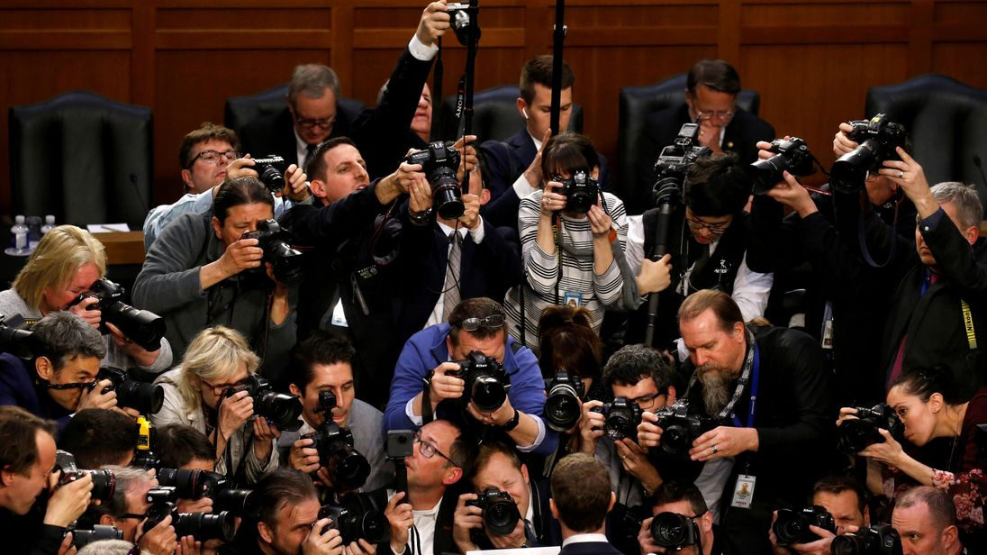 Facebook CEO Mark Zuckerberg is surrounded by members of the media as he arrives to testify before a Senate Judiciary and Commerce Committees joint hearing regarding the company's use and protection of user data, on Capitol Hill in Washington, U.S., April 10, 2018. REUTERS/Leah Millis