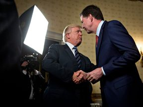 James Comey and Donald Trump shake hands