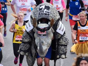 Runners are being told to rethink fancy dress because of hot conditions. Pictured: A runner in 2017's event