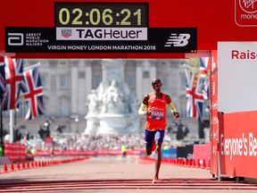 Mo Farah crosses the finish line