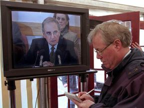 BELFAST, UNITED KINGDOM: Senator George Mitchell goes live on TV 10 April to announce that the peace agreement was finally reached by the parties at the Northern Ireland peace talks, some 17 hours after the midnight deadline. (Photo credit should read ALAN LEWIS/AFP/Getty Images)