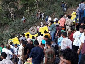 Poeple gather at the site of the crash