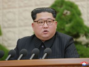 Kim Jong Un speaks during the Third Plenary Meeting of the Seventh Central Committee of the Workers' Party of Korea