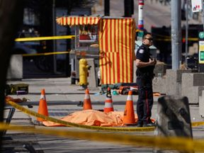 A police officer near one of the victims of the incident