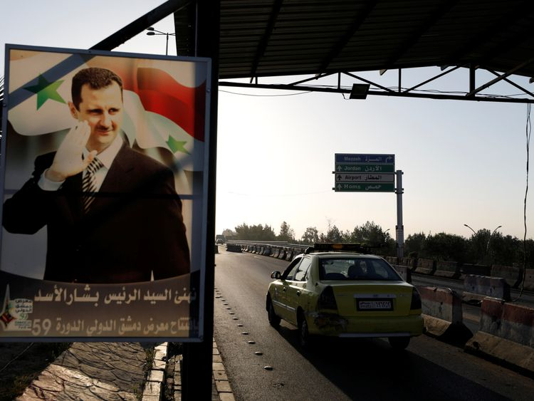 A picture of Bashar al Assad along the road to the main airport in Damascus