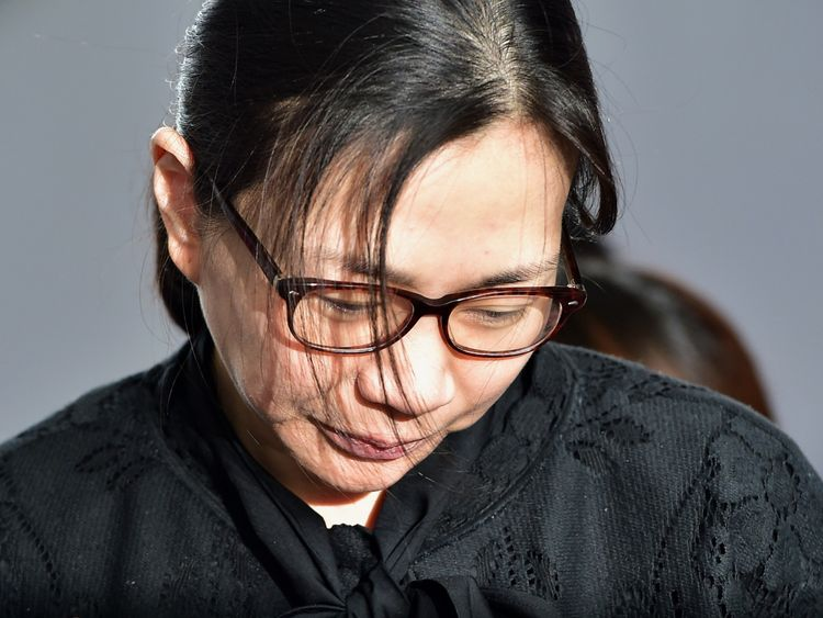 Former Korean Air (KAL) executive Cho Hyun-Ah is surrounded by journalists after she received a suspended jail sentence and was freed by a Seoul appeals court in Seoul on May 22, 2015, after she had been jailed for a year in February for disrupting a flight in a rage over macadamia nuts