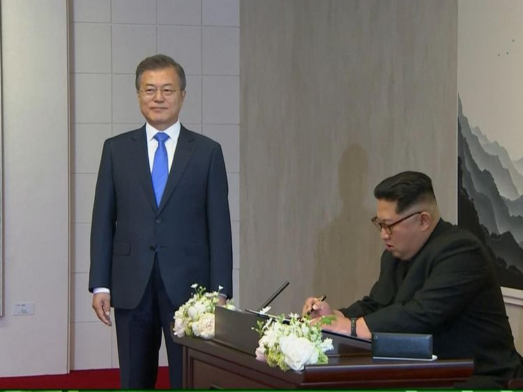 Kim signs te guest book in the Peace House