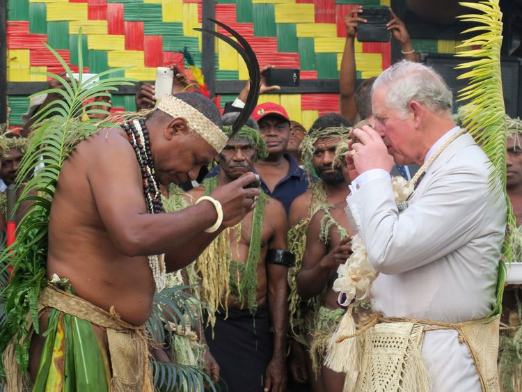 Prince Charles drinks kava with Chief Seni Mao Tirsupe, the President of the Malvatumauri Council of Chiefs, to the Chiefs Nakamal in Port Vila, Vanuatu