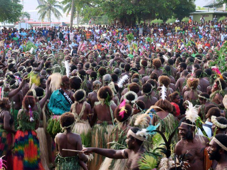 Vanuatu residents perform the 'kastom' dance for Prince Charles during his visit to Port Vila on April 7, 2018