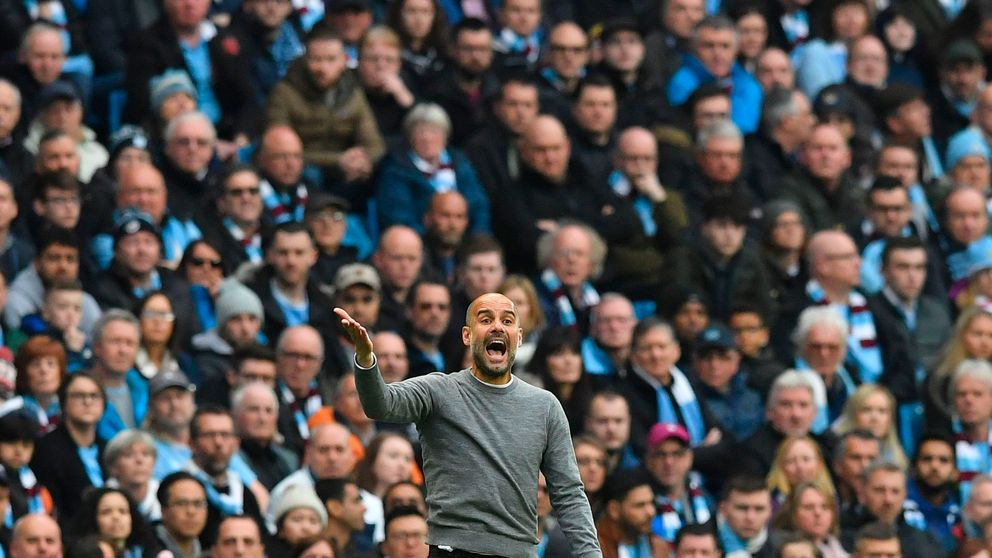 Manchester City's Spanish manager Pep Guardiola gestures on the touchline during the English Premier League football match between Manchester City and Manchester United at the Etihad Stadium in Manchester, north west England, on April 7, 2018
