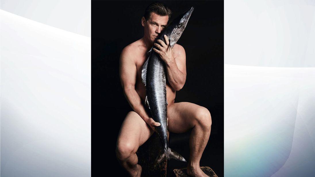 Josh Brolin strips naked and poses with a Hawaiian Wahoo fish. Pic:Fishlove/Alan Gelati