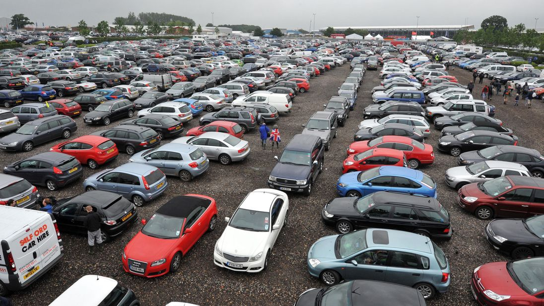 Cars parked bumper to bumper in a car park at Silverstone before the British Grand Prix at Silverstone Circuit