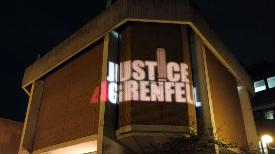 Justice4Grenfell is beamed onto Kensington Town Hall as votes are counted