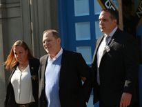 Harvey Weinstein is led out of the New York Police Department's First Precinct in handcuffs
