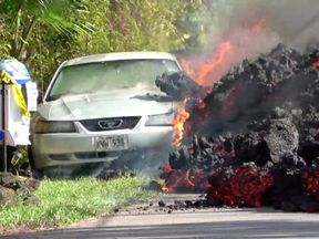 Lava engulfs a Ford Mustang in Puna, Hawaii