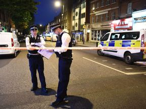 Police officers at the scene in Upper Street following the attack
