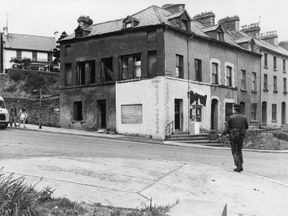 An armed British soldier on patrol in the nationalist Bogside district of Derry City in 1972