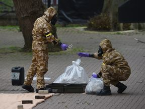 Military personnel at the site near the Maltings in Salisbury where Russian double agent Sergei Skripal and his daughter Yulia were found on a park bench