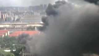 Smoke billows into the sky over Nanning City in China from a warehouse fire