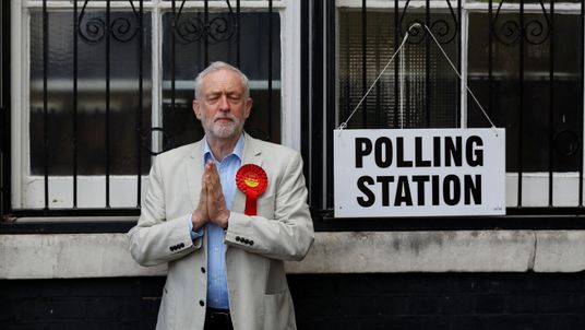 Jeremy Corbyn gestures after voting in local government elections in London