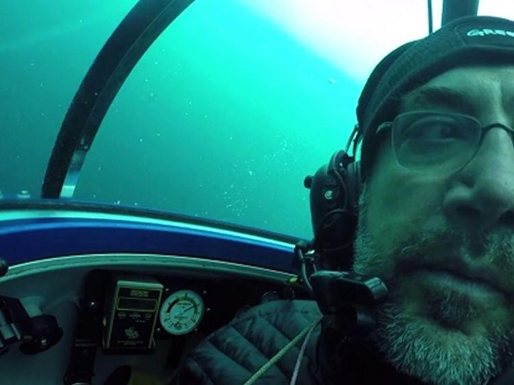 Javier Bardem looking at plastic pollution in Antarctica