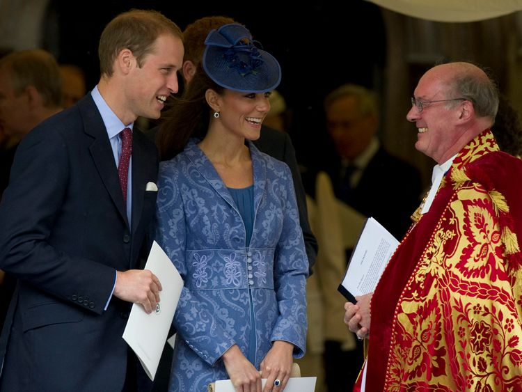 The Duke and Duchess of Cambridge talk with the Dean of Windsor, Reverend David Conner, after a church service to mark Prince Philip's 90th birthday in Windsor, west of London, on June 12, 2011